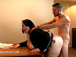 Enchase bent over a desk