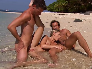 Katy Caro tries outdoor sex at the beach with two unlucky guys