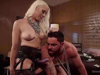 Mommy uses the strap-on toy on her male slave's tight arse
