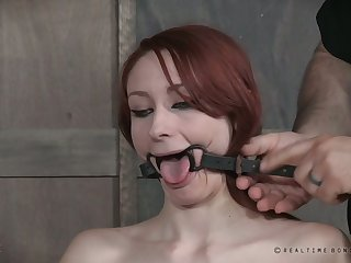 Svelte long legged redhead gets gagged coupled with her tongue is smashed
