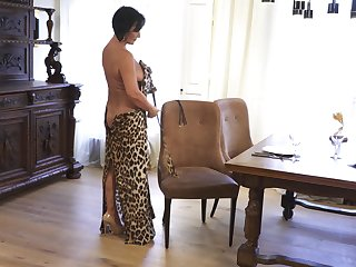 Mature lady makes leopard print dress look sexy and she masturbates a lot